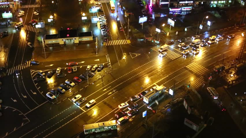 MOSCOW, RUSSIA - NOV 17, 2013: Night view of car traffic at intersection of Sokolnicheskaya Square and Rusakovskaya street. | Shutterstock HD Video #8653723