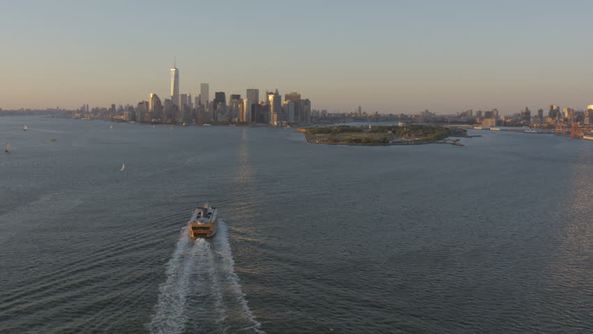 Aerial Staten Island Ferry boat sunset Lower Manhattan Skyscrapers 1 WTC East River New York RED EPIC #8657629