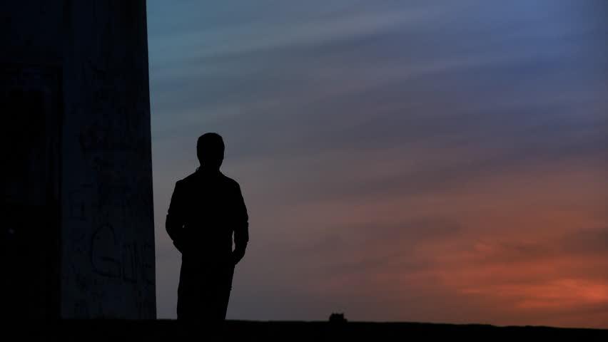 Thoughtful man standing towards sunset/sunrise. Full HD, 1080p, 1920x1080. #866122