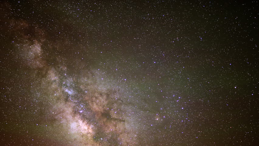 4K Astrophotography time lapse footage of milky way galaxy over alpine forest in Utah