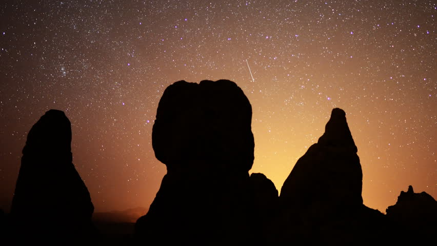 4K Astrophotography time lapse footage of starry sky over monolithic formations in Trona Pinnacles, California