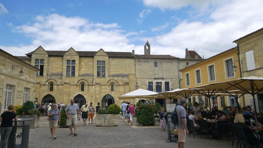 ST. EMILLION FRANCE - AUGUST 2014: The area beside the L'eglise Monolithe or Monolithic Church is lined with restaurants and cafes. During the summer months this is a very busy town.