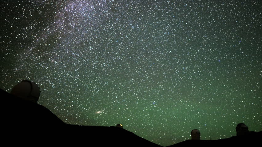 4K Astrophotography time lapse with pan right motion of stars over Mauna Kea Observatories in Hawaii
