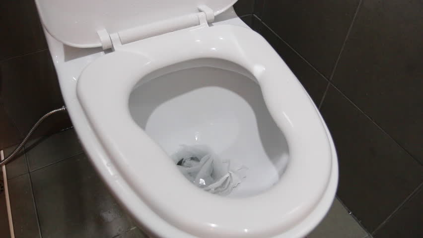 Flow of water and lowering a toilet bowl lid, flush the toilet