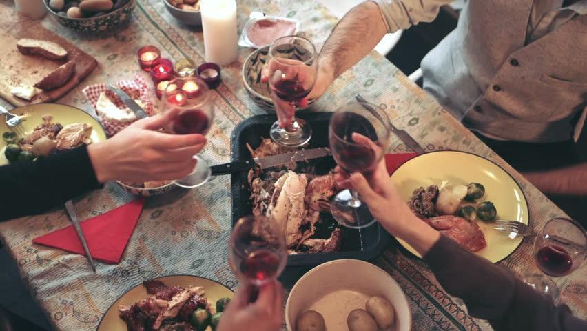 Friends enjoying wine at Christmas dinner