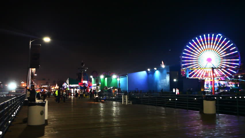 LOS ANGELES, CALIFORNIA/USA  JANUARY/2015: View of the attractions of the Santa Monica Pier at night [January 9, 2015] in [Los Angeles] - HD stock footage clip