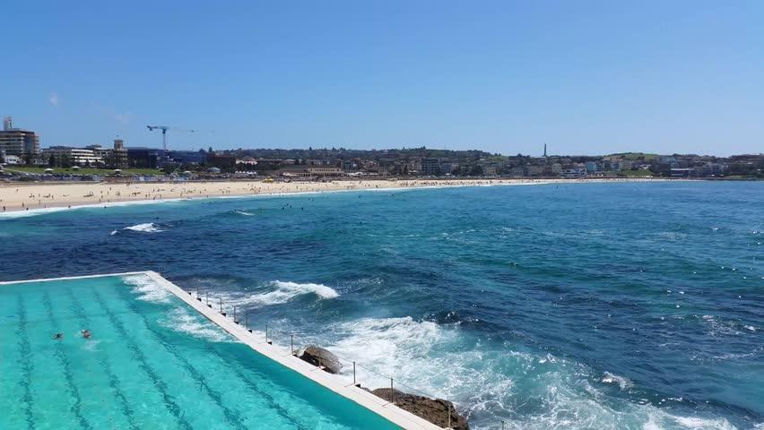 BONDI BEACH, SYDNEY, AUSTRALIA: Bondi Beach or Bondi Bay is a popular beach on a hot summers in Sydney, Australia on January 22, 2015. | Shutterstock HD Video #8703196