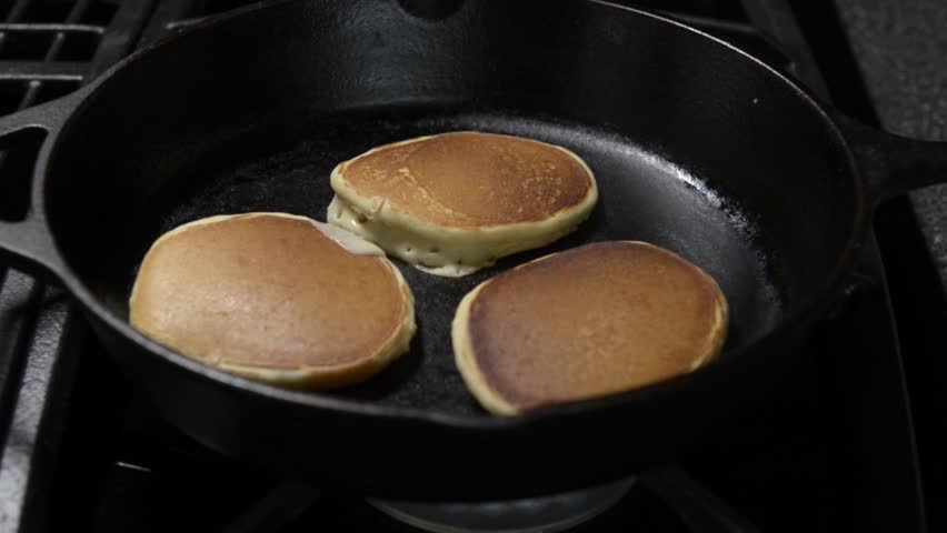 pancakes in a cast iron skillet
