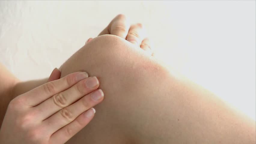 close-up of a woman doing a knee massage at home - HD stock video clip