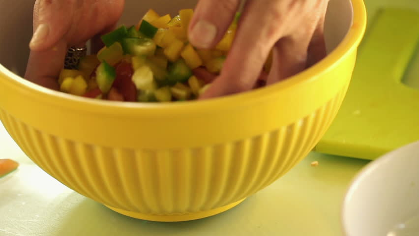Closeup shot of female hands mixing salad, slow motion shot at 120fps