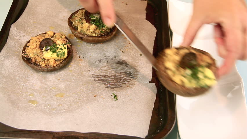 Serving stuffed mushrooms straight from the oven on to a dish.