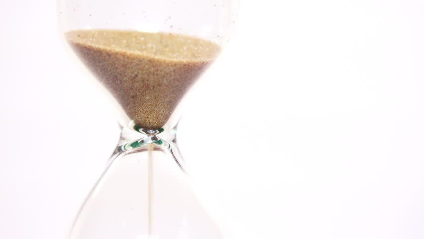 Close-up View of Sand Flowing Through an Hourglass on white background. 4K Ultra HD 3840x2160 Video Clip