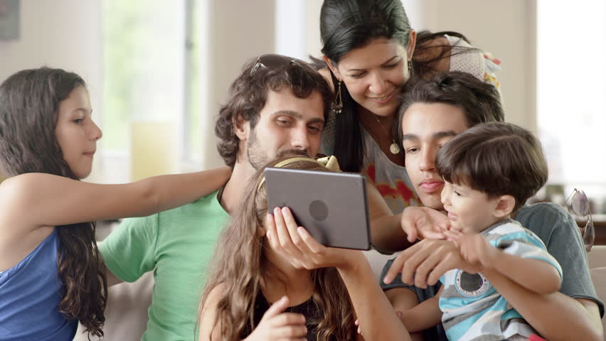Family using a tablet computer in living room - 4K stock footage clip
