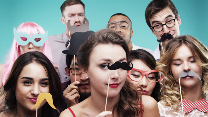 Multi racial group of funny people celebrating slow motion party photo booth Red Epic Dragon