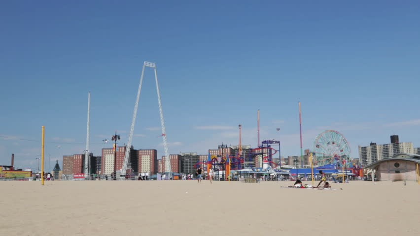NEW YORK CITY/USA - CIRCA JULY 2013: Coney Island. Wide shot boardwalk, amusement park and apartment buildings. 1080p HD. - HD stock footage clip