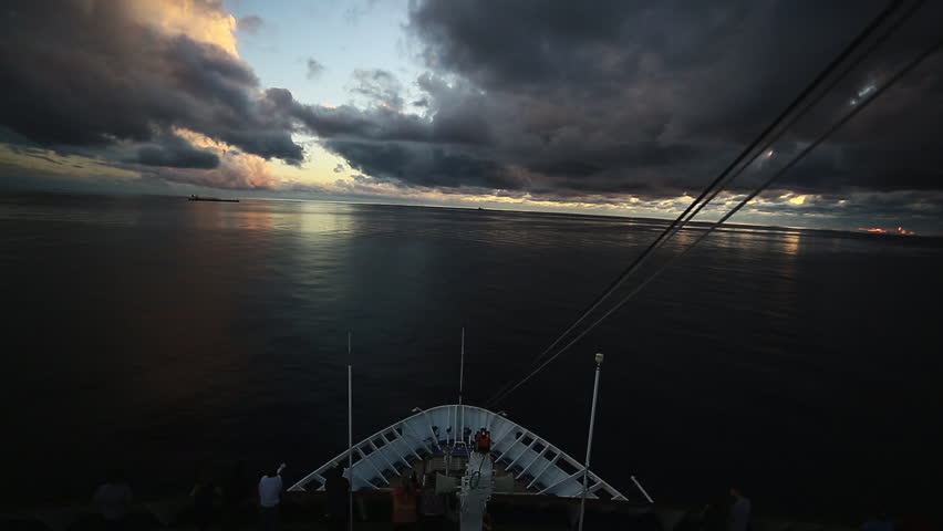 Caribbean cruise in the Bahamas. POV shot with clouds during sunset. 1080p HD.