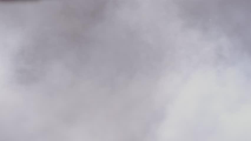 Smoke / steam cloud in slow-motion against black background | Shutterstock HD Video #8772226