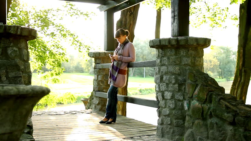 Female student in park sending sms - HD stock footage clip