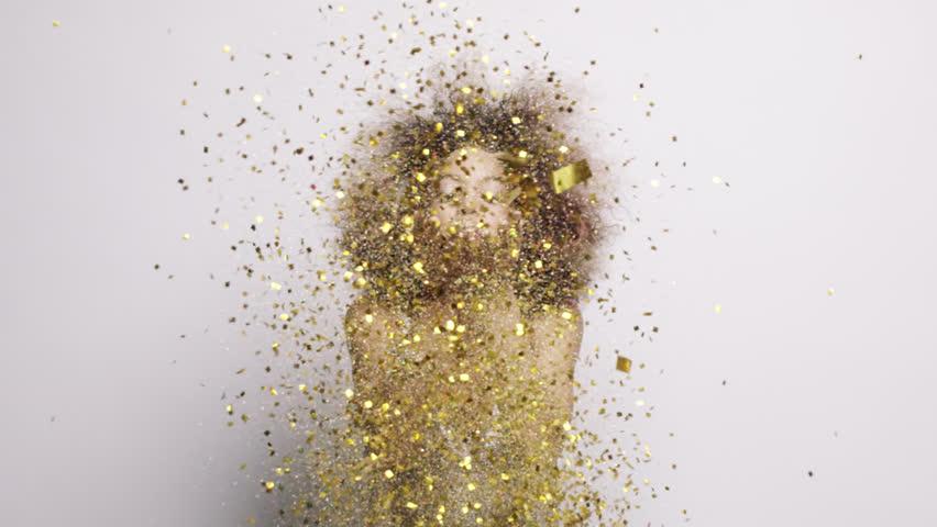 Beautiful hispanic woman blowing gold glitter confetti slow motion - Red Epic Dragon #8784205