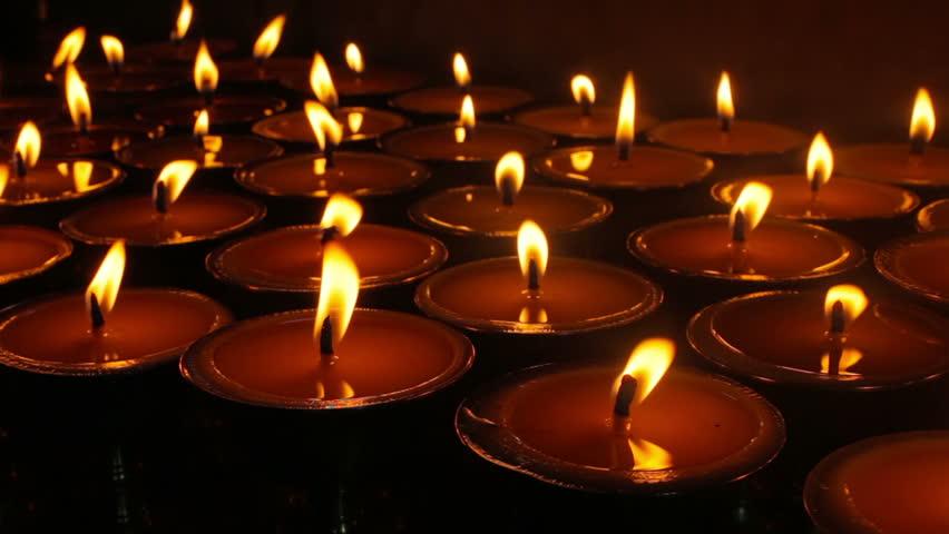 Burning candles in Tibetan Buddhist temple. Himachal Pradesh, India