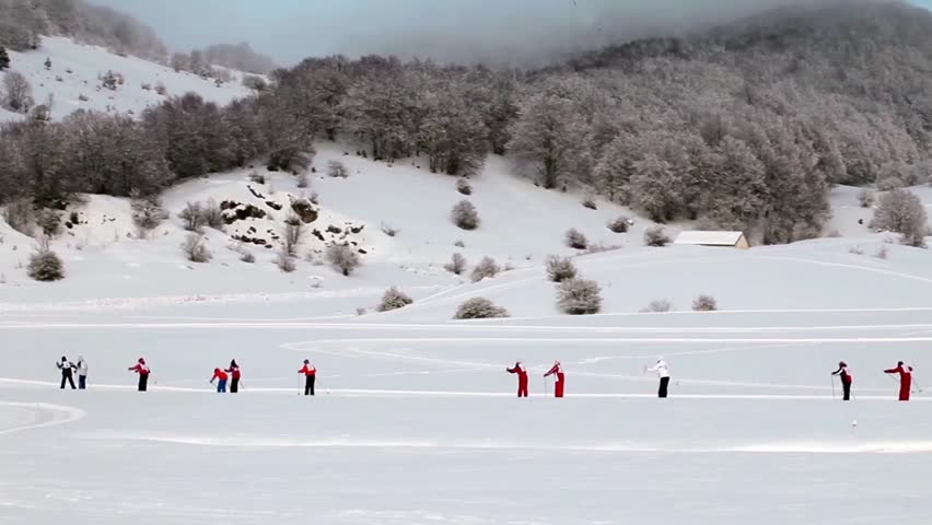 Video clip of children country-cross skiing in a single file, Abruzzi, Italy.