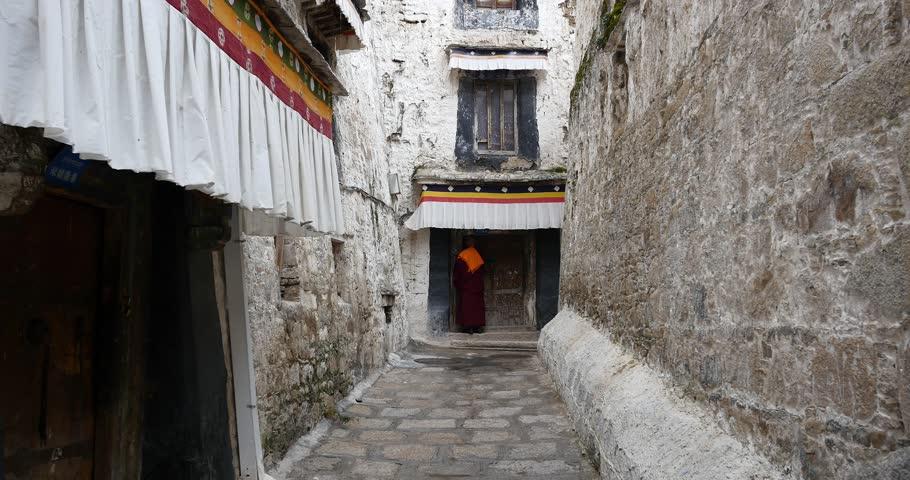OCTOBER 09, 2014:4k lhasa drepung in tibet,famous tibetan temple,ancient buddhist building. gh2_08774_4k - 4K stock footage clip