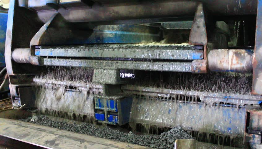 Shale shaker on an offshore oil rig separating the cutting from water based mud  - HD stock footage clip