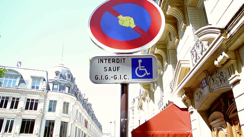 PARIS, FRANCE - CIRCA 2015: Panning over altered with shaking hands street transportation sign  - HD stock video clip