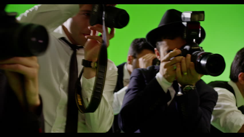 4K Group of paparazzi. Photo shoot on green screen. Slow motion. Shot on RED EPIC Cinema Camera.