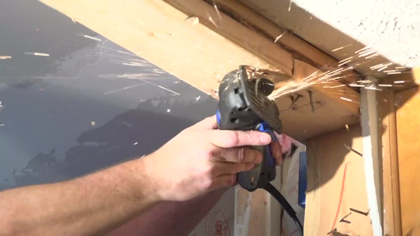 Sawing nail with sparks - HD stock footage clip