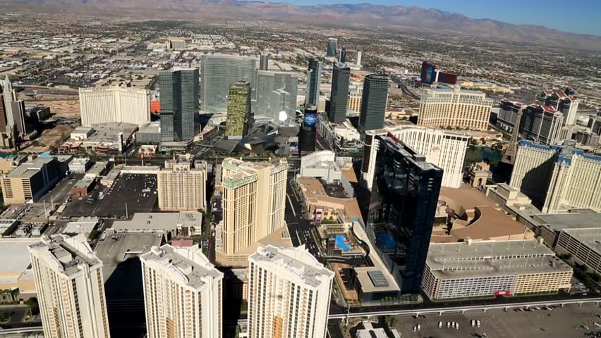 Aerial of the Las Vegas Strip, Internationally known for the concentration of resort hotels and casinos along its route. One of the most popular destinations for tourists in the USA, and the world. - HD stock video clip
