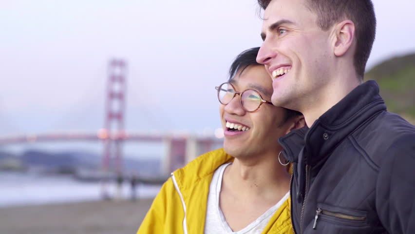 Man Surprises His Partner And Watches The Sun Go Down With Him At The Beach (Golden Gate Bridge In The Background)