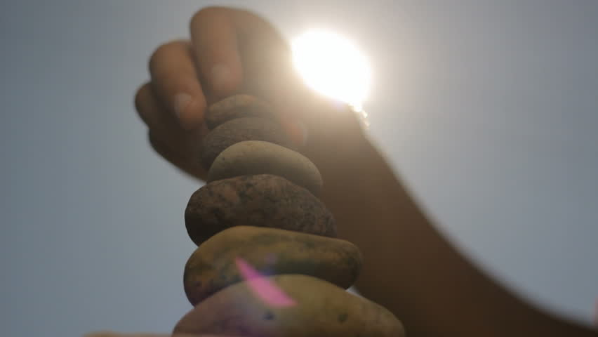 Putting stones on each other to the sun, peace, calm
