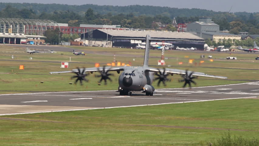 FARNBOROUGH, UK  JULY 17, 2014: Airbus A400m demonstrates a 180 degree taxi turn.