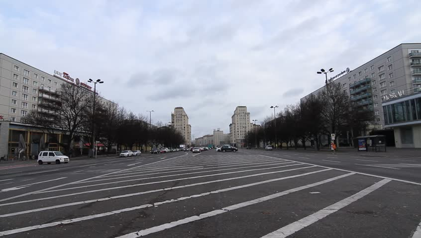 BERLIN, GERMANY - JANUARY 19: Traffic pass by on the famous Karl Marx Allee on January 19, 2015 in Berlin, Germany.  - HD stock video clip