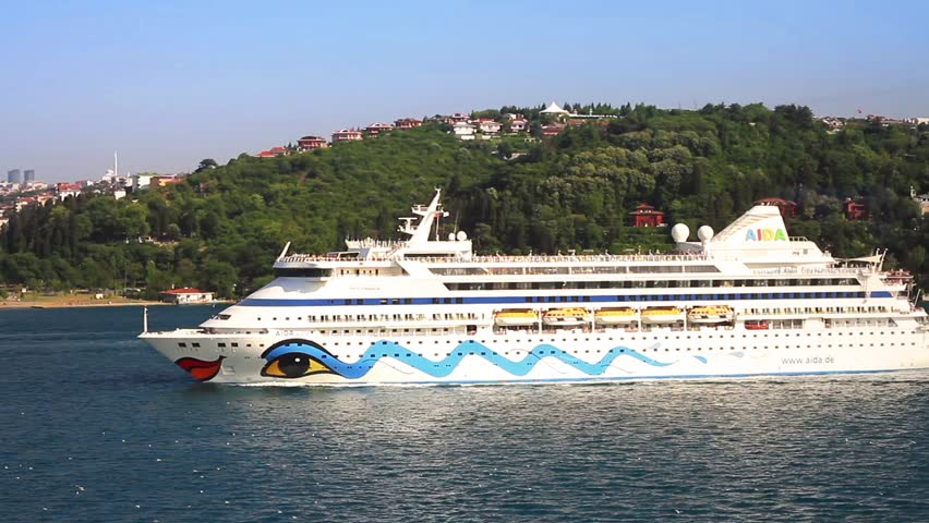 ISTANBUL - JULY 5, 2012: Luxury ship AIDA Aura cruising into Bosporus towards Blacksea. A 203 mt long, 28 mt width vessel, launched into the sea in 2003 and has a capacity of 1,300 passengers
