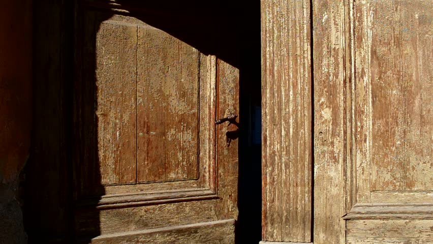 An Old Wooden Door Is Closing Slowly. Can Be Used As A ...