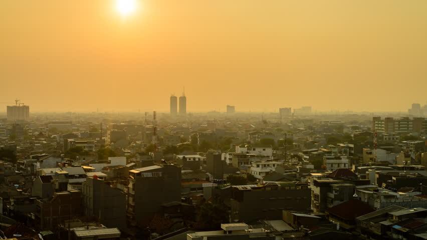 A Hazy Sunset As Fog Blankets Jakarta Skyline. Timelapse. Jakarta City, Indonesia   Shutterstock HD Video #8929258