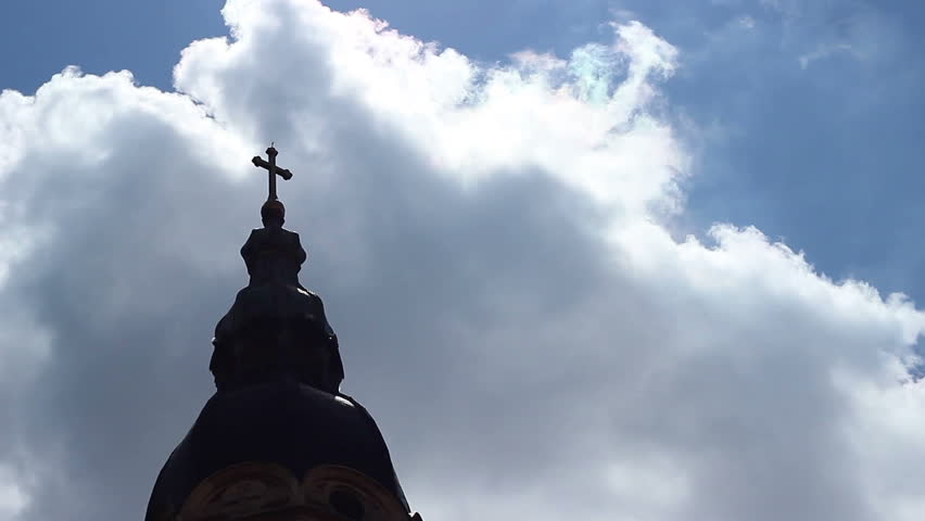 A cathedral church cross in shaddows, oriented towards big sky and God. - HD stock footage clip