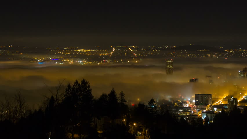 Panning Time Lapse Movie of Thick Dense Rolling Fog Over Downtown City of Portland Oregon with Snow Covered Mount Hood One Early Winter Morning at Sunrise 1080p. - HD stock video clip