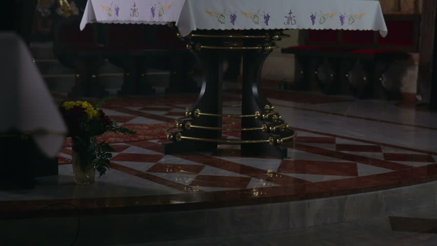 Priest shows off the old church. From low to hight footage s of a middle age couple meeting the priest at the alter in beautiful catholic church. - HD stock video clip