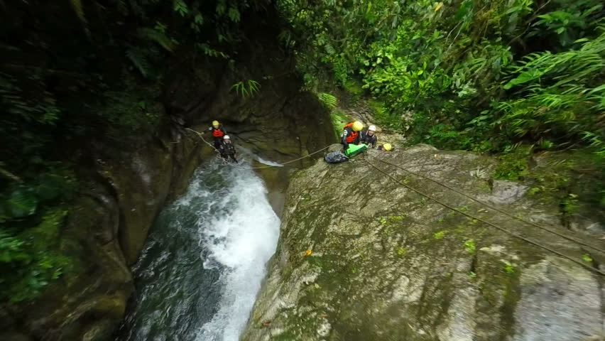 First person view of a waterfall jump while canyoning in ecuadorian rain forest, hand held action camera | Shutterstock HD Video #8960848