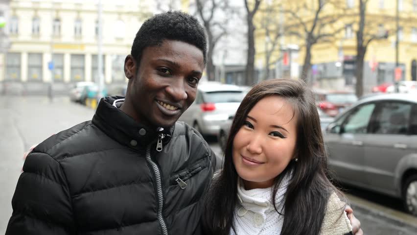 Asian girls with black men congratulate, magnificent
