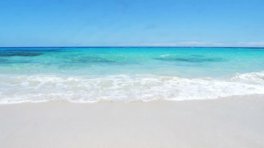 White Sandy Beach Lazy Waves Of Crystal Clear