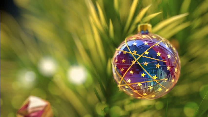 Christmas greeting card with shining christmas tree and small house on background - HD stock footage clip