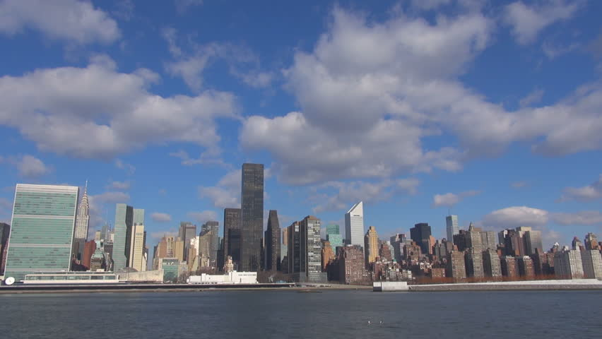 Timelapse of New York City, Manhattan downtown and cloud pass, boat sail and blue sky by day | Shutterstock HD Video #9000421