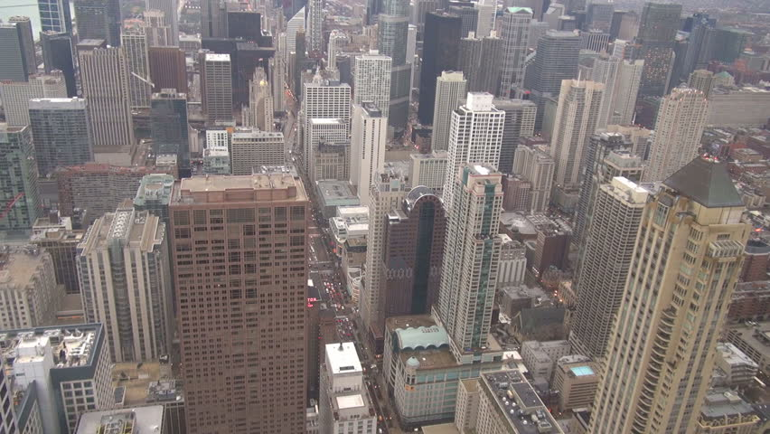 Aerial view of Chicago downtown and traffic car on busy avenue, rooftop of skyscraper by day | Shutterstock HD Video #9000610