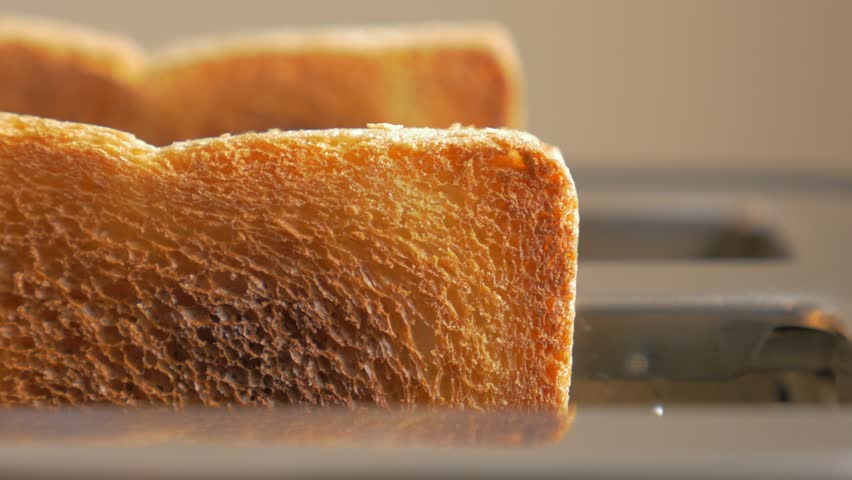 Roasted toast bread popping up from toaster machine while smoke comes out 4K 2160p UHD footage - Two toast pieces popping out from toaster 4K 3840X2160 UHD video | Shutterstock HD Video #9006523