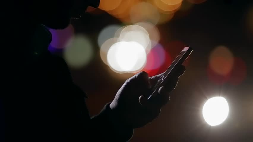man with the phone in the night
