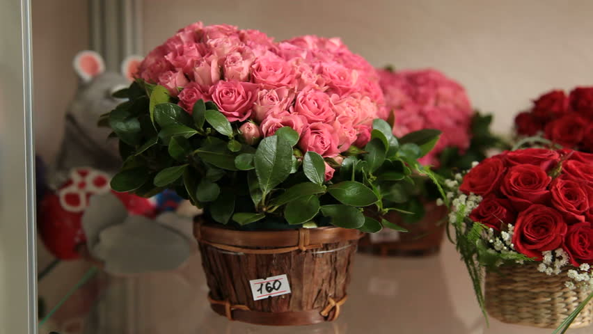 Floral arrangements in form of heart on shelf in flower shop for Valentine's Day - HD stock video clip